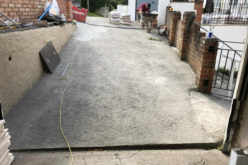 Resin Drive, Paths And Patio Transformation  With Concrete Shed Base & Rendored patio walls in Newton Abbot